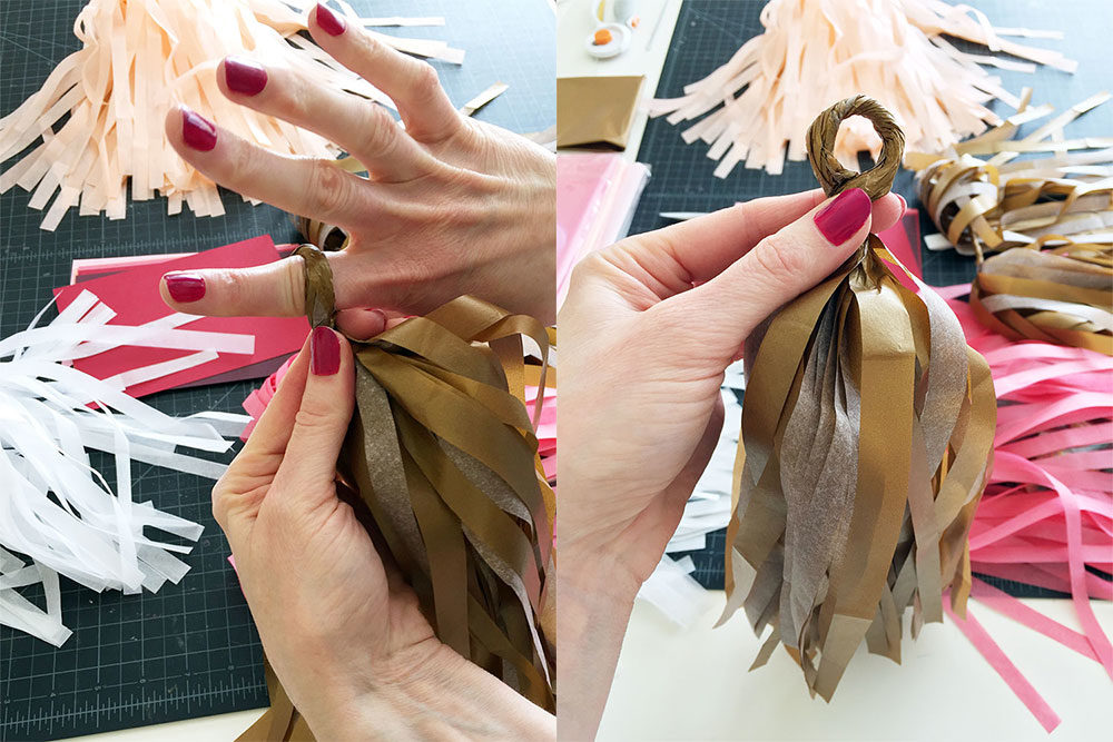 Making tassels for the custom handmade tissue tassel garland for client bridal shower